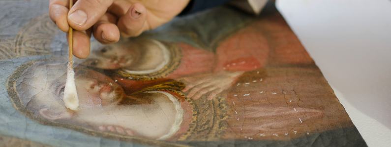 an expert restorer performs the finishing touches to a sacred image of the Madonna dating from 1600